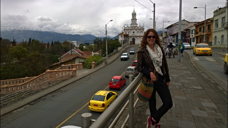 Nora with a church behind her