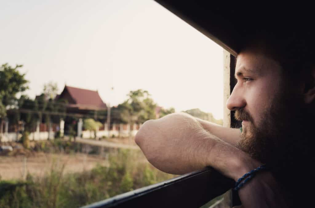 Jeremy looking out a window in the countryside