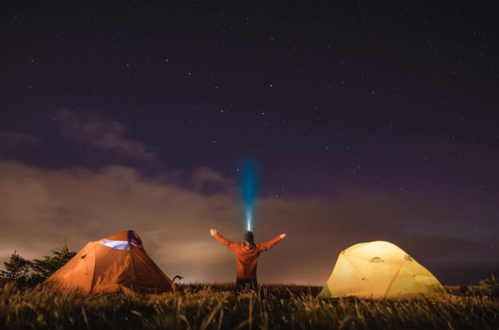camping at night with tents